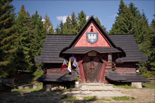 Kaplica Matki Boskiej Lesnej Królowej Gorców pod Turbaczem nazywana także Kaplicą Papieską, Partyzancką lub Pasterską